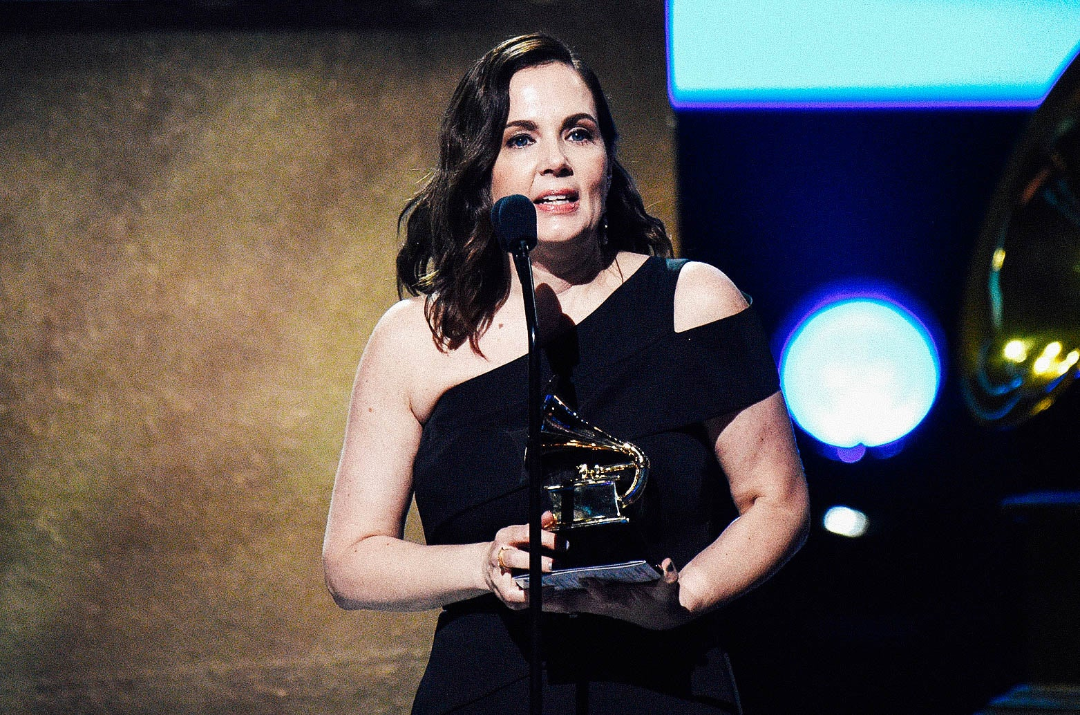 Singer-songwriter Lori McKenna accepts the award for Best Country Song onstage at the 59th Grammy Awards.