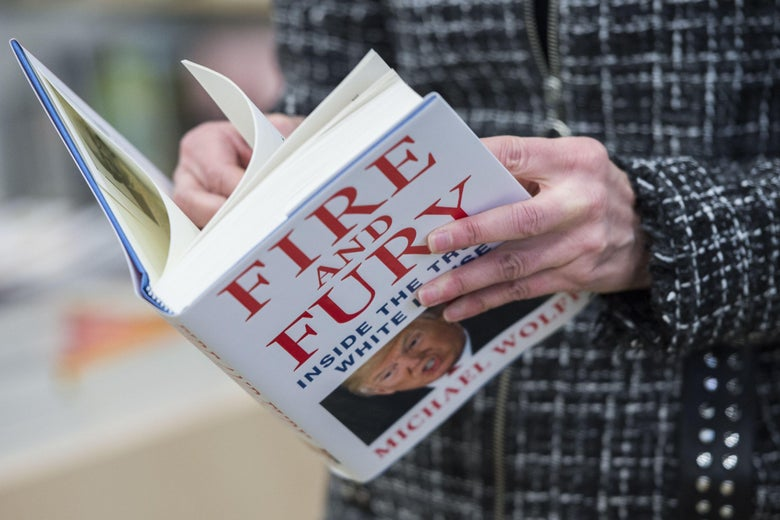 A man holds a copy of the book 'Fire and Fury: Inside the Trump White House' by Michael Wolff after buying it at a bookstore in Washington, DC on January 5, 2018.