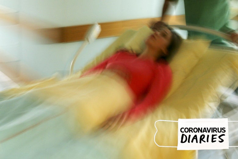 A woman in a hospital bed, the image blurred