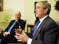 Ehud Olmert with George W. Bush. Click image to expand.