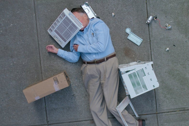 An older white man lies sprawled on the pavement, in loose khakis and a blue Oxford tucked into his waist, the pieces of a broken AC unit scattered around him