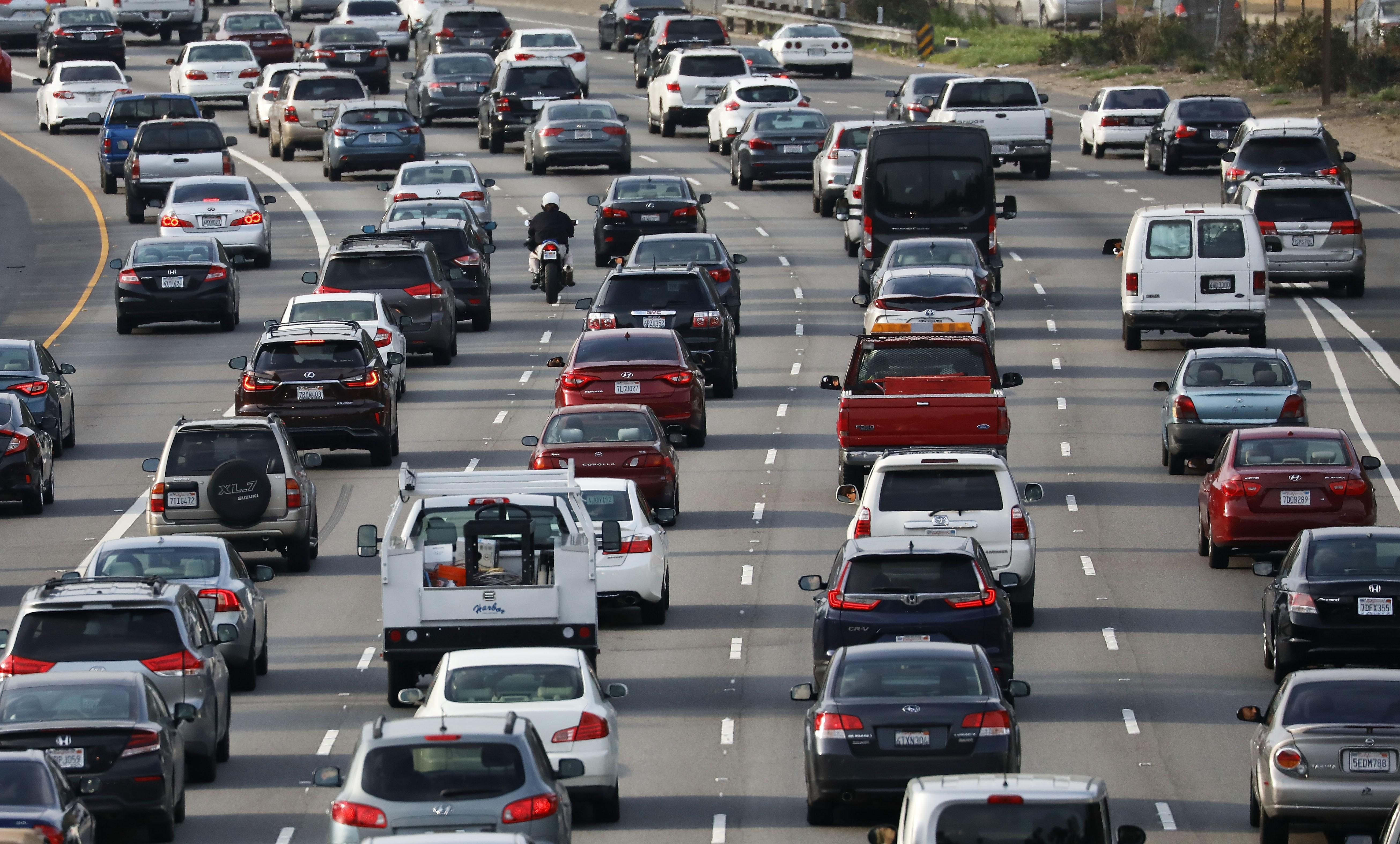 Cars sitting in traffic on an LA freeway