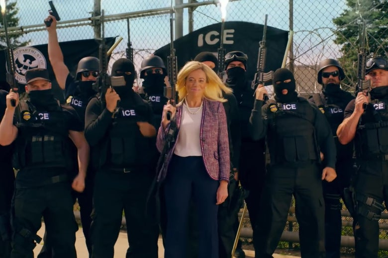 Michelle Wolf stands in front of a group of black-clad ICE agents holding automatic weapons.