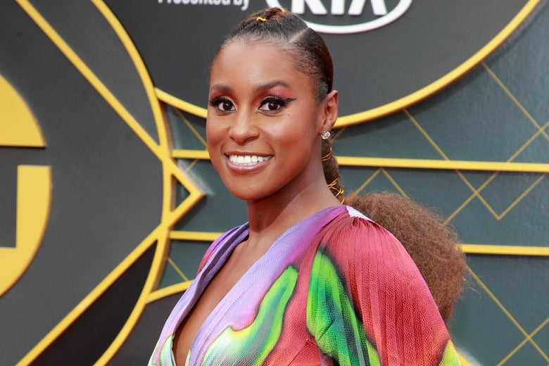Issa Rae on a red carpet.