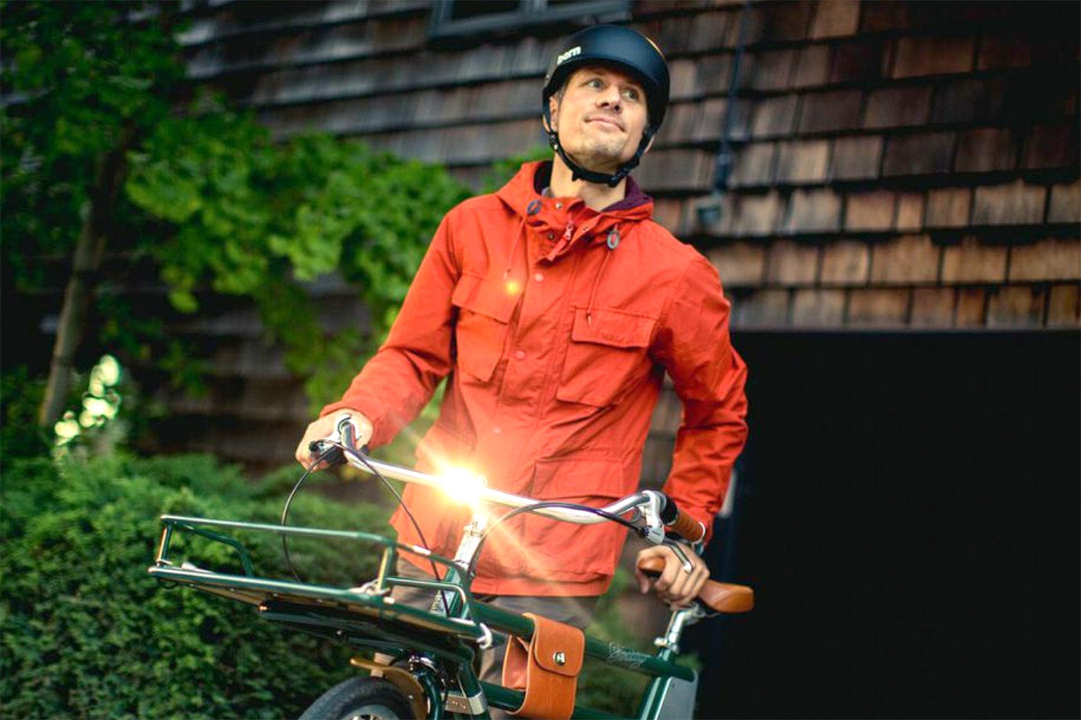 A man rides the Faraday Porteur e-bike.