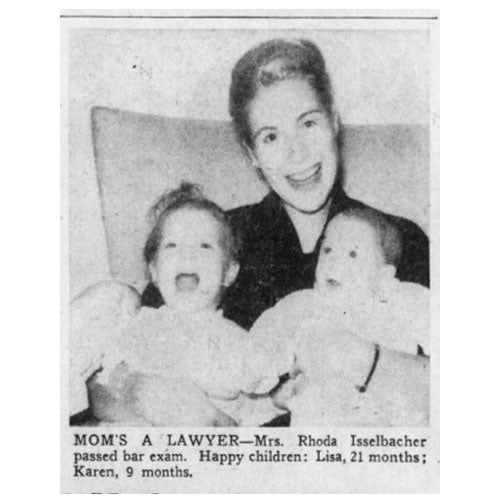"""A newspaper clipping says """"Mom's a lawyer"""" and features a photo of Rhoda with two daughters."""
