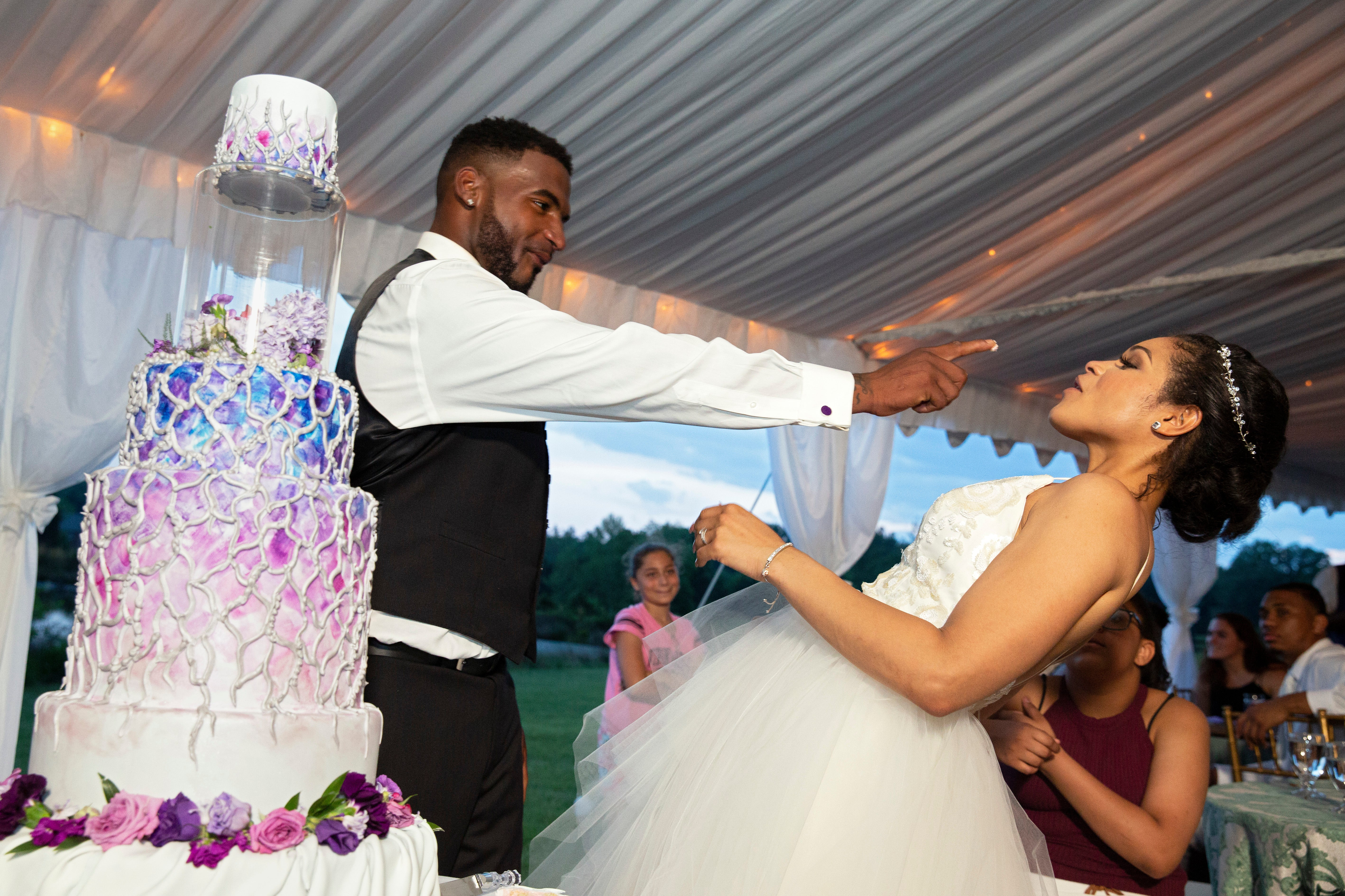 Marcus Martin and Marissa Blair taste their wedding cake.