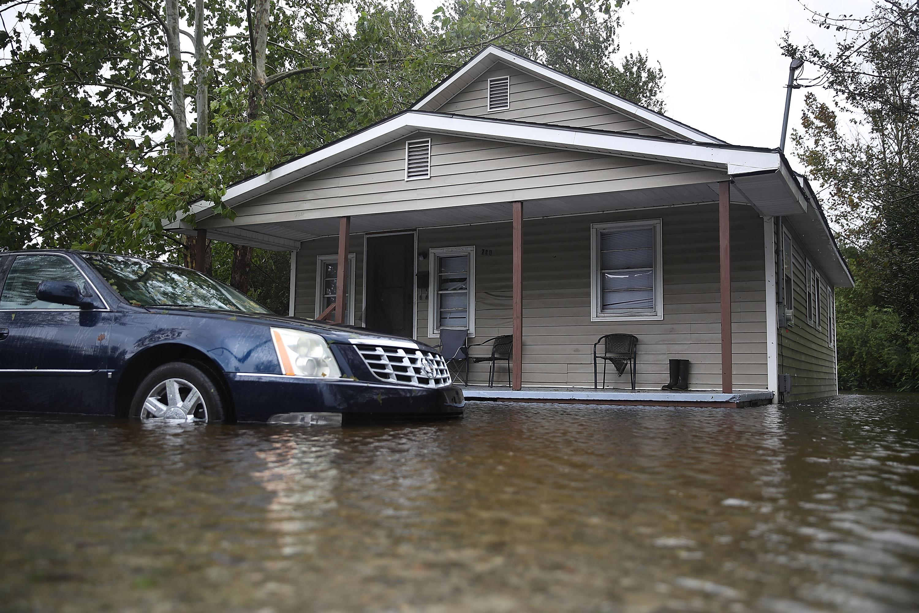 Flood waters surround a home after Hurricane Florence passed through the area on September 15, 2018 in Warsaw, North Carolina.