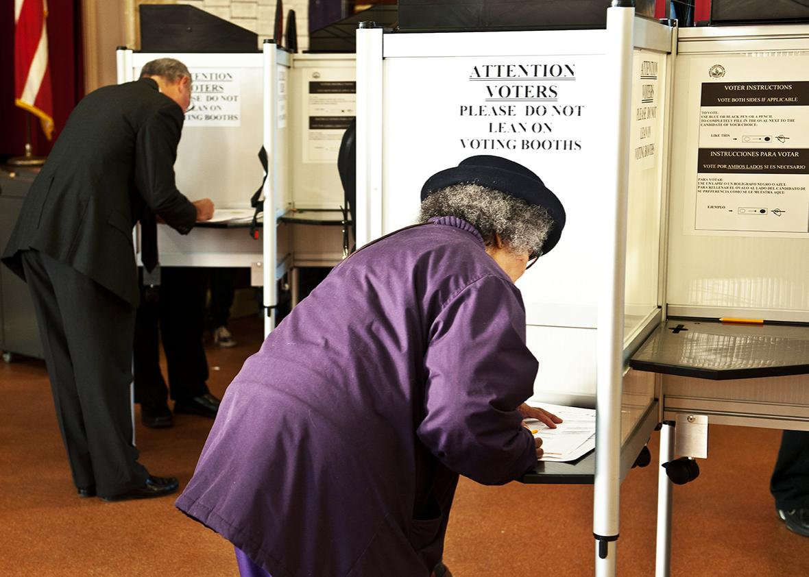 People fill their ballots at a polling station in Washington, D.C., on Nov. 6, 2012.