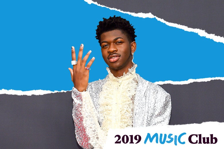 Lil Nas X holding his hand up, palm facing him, as if to show off his rings.