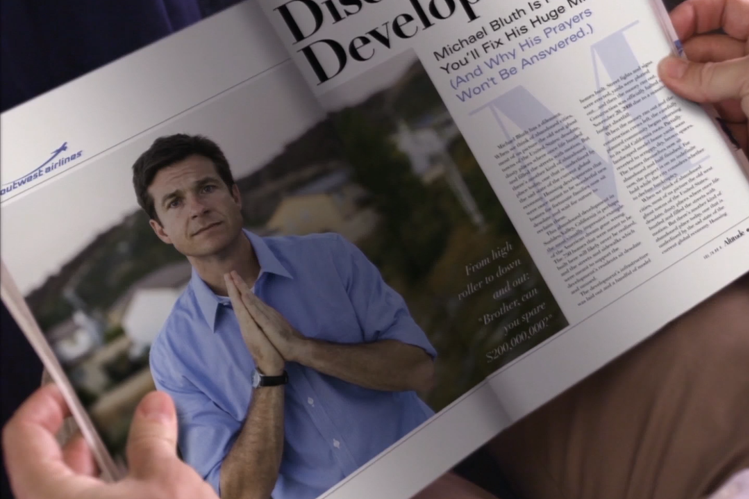 Jason Bateman, as his character Michael Bluth, appears in a magazine photo with his hands clasped, looking apologetic.