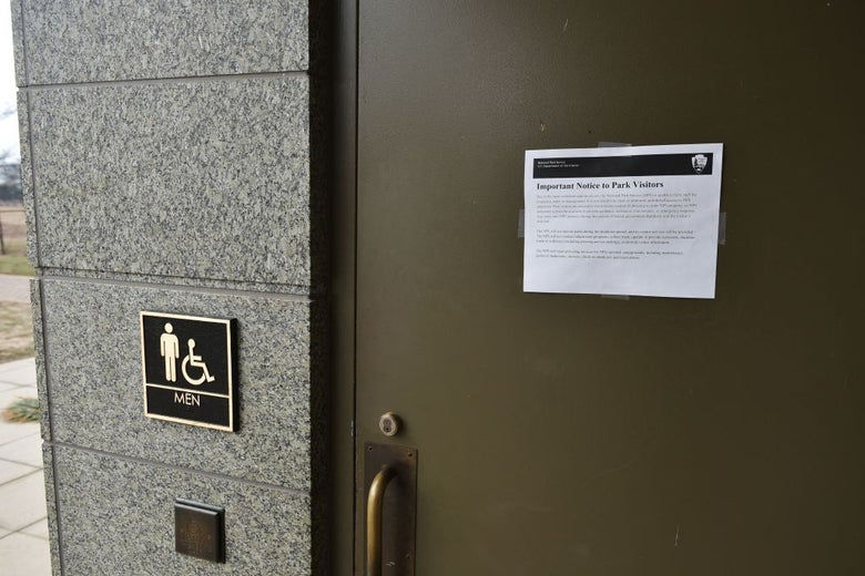 A notice about the government shutdown on the door of the men's bathroom at the Martin Luther King Jr. Memorial in Washington, D.C.