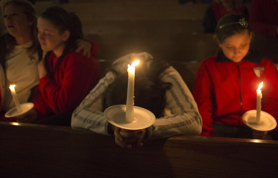 A woman mourns during a candlelight church service at St Mary's for victims of a fertilizer plant explosion in the town of West, near Waco, Texas April 18, 2013.