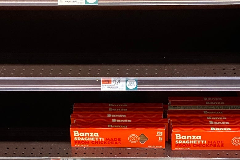 Banza pasta boxes on an otherwise empty shelf.