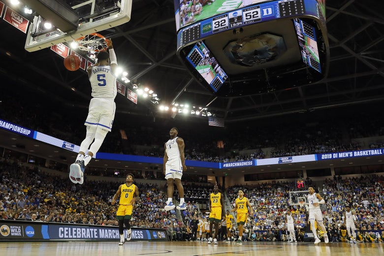 COLUMBIA, SOUTH CAROLINA - MARCH 22:  RJ Barrett #5 of the Duke Blue Devils dunks the ball as teammate Zion Williamson #1 celebrates against the North Dakota State Bison in the second half during the first round of the 2019 NCAA Men's Basketball Tournament at Colonial Life Arena on March 22, 2019 in Columbia, South Carolina. (Photo by Kevin C. Cox/Getty Images)
