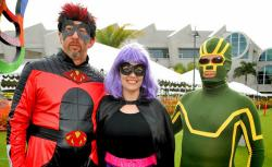 Three Comic-Con enthusiasts dress up as their favorite characters outside the 2012 Comic-Con.