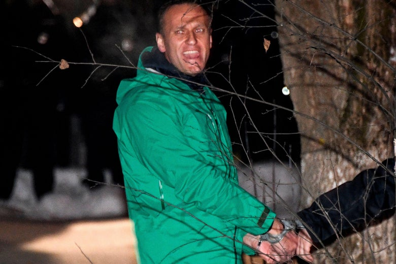Navalny appears to shout toward the camera as he is led away in handcuffs