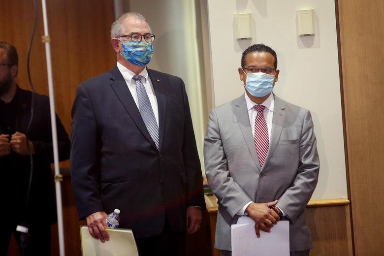 Mike Freeman and Keith Ellison stand next to each other wearing face masks.