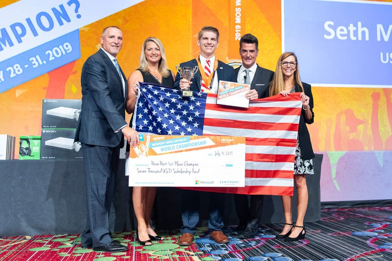 Maddox and others hold up an American flag and his prize check.