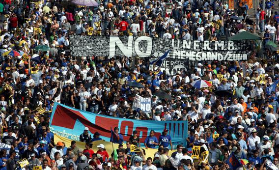 People demonstrate during the closing rally against the constitutional amendments promoted by Venezuelan president Hugo Chavez
