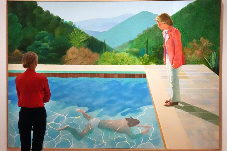 A woman contemplates Hockney's painting