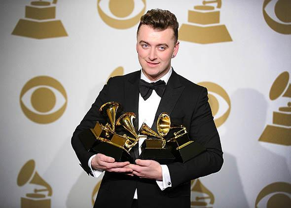 Singer Sam Smith poses in the press room at the 57th Grammy Awards