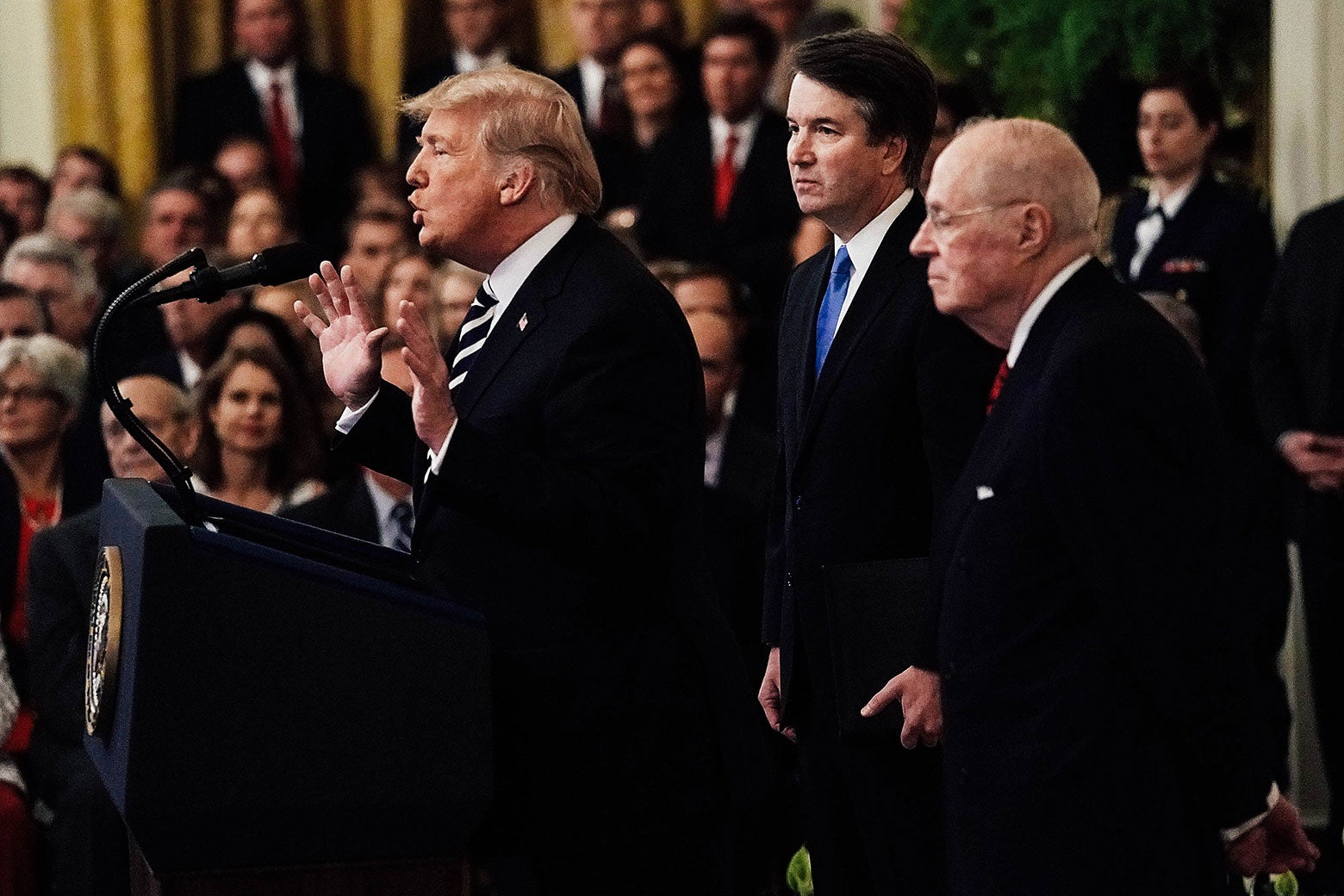 President Donald Trump speaks as Supreme Court Justice Brett Kavanaugh and retired Justice Anthony Kennedy look on during Kavanaugh's ceremonial swearing-in at the East Room of the White House on Monday.