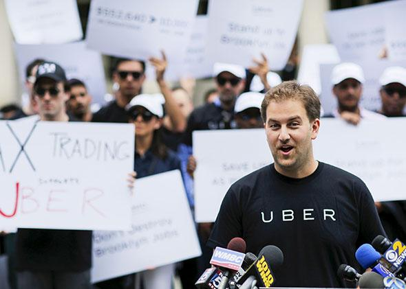 Uber's general manager for New York, speaks to the media while U,Uber's general manager for New York, speaks to the media while Uber riders and driver-partners.