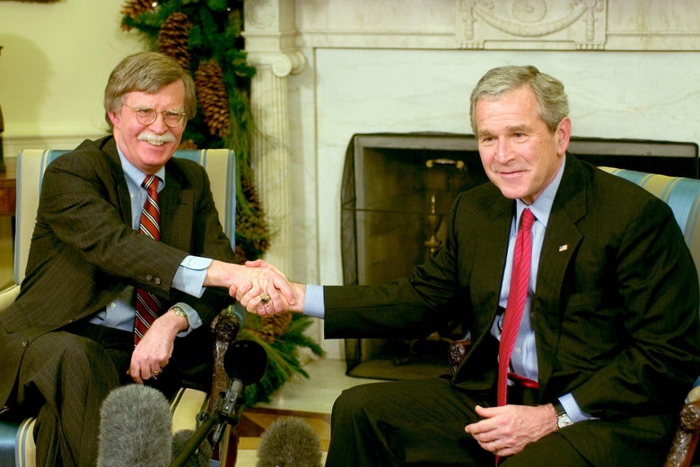 WASHINGTON - DECEMBER 4:  (AFP OUT) US President George W. Bush (R) and Ambassador to the UN John Bolton (L) meet in the Oval Office of the White House December 4, 2006 in Washington, DC. Bush accepted Bolton's resignation as Ambassador to the United Nations when his term is up in January 2007.  (Photo by Ron Sachs-Pool/Getty Images)
