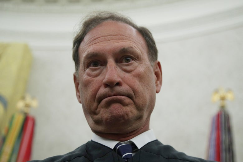 Alito standing in his robes