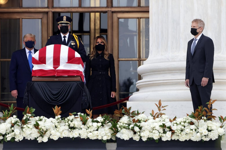 Donald and Melania Trump stand in front of Ruth Bader Ginsburg's casket in the entryway of the Supreme Court while Neil Seigel stands by.