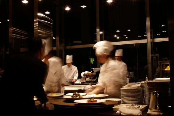 Chefs in a restaurant kitchen.