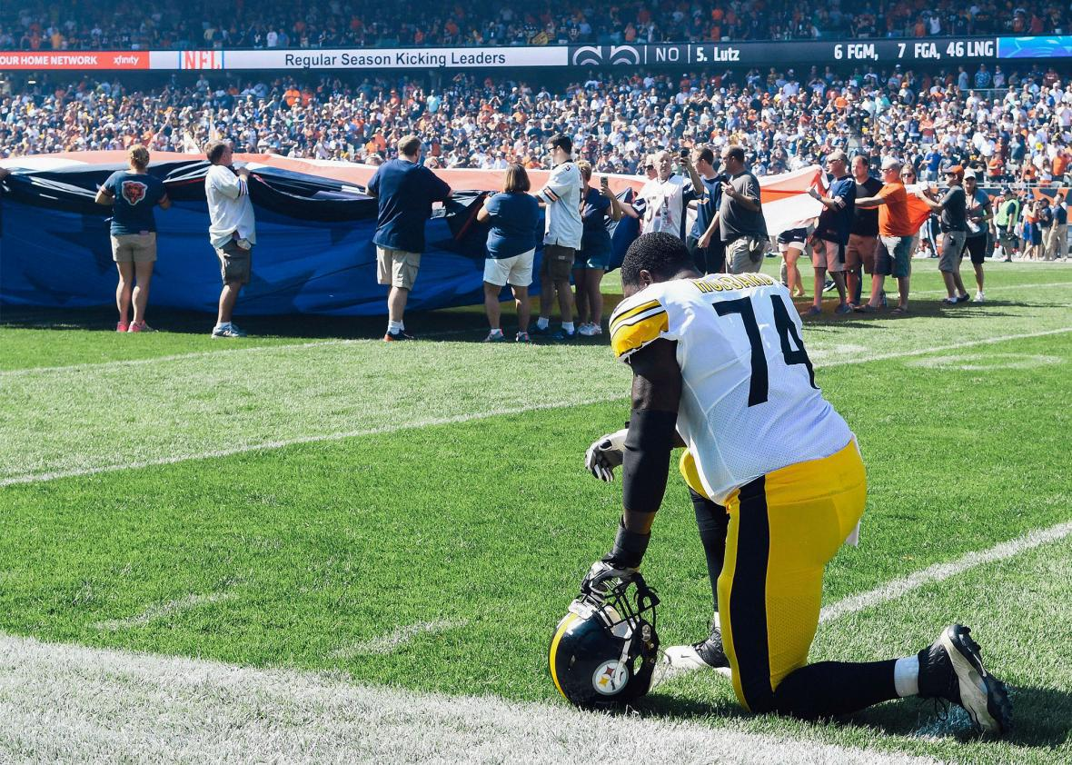 Pittsburgh Steelers offensive tackle Chris Hubbard takes a knee