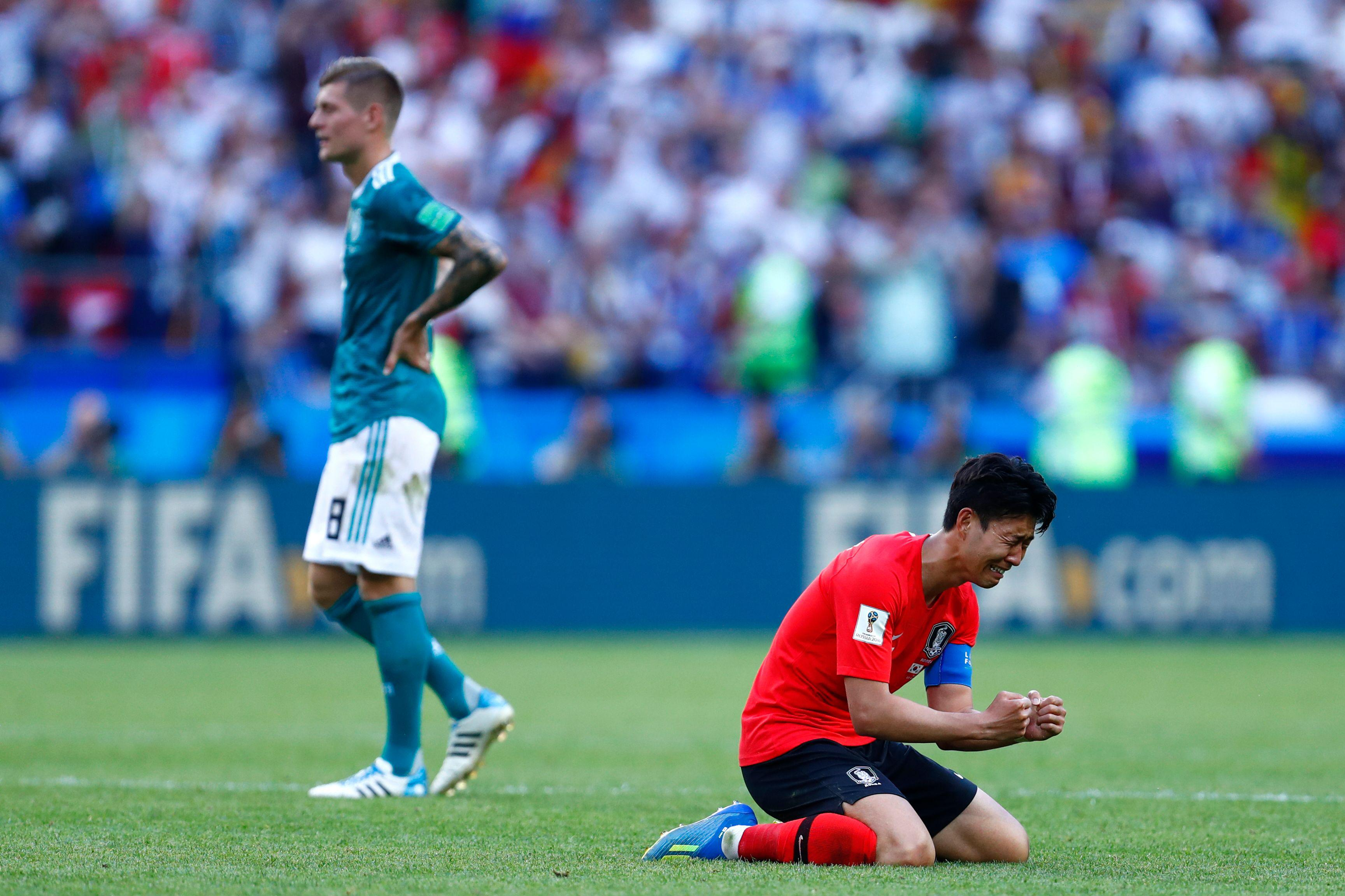 South Korea's forward Son Heung-min (R) reacts after his team did not qualify following the Russia 2018 World Cup Group F football match between South Korea and Germany at the Kazan Arena in Kazan on June 27, 2018. (Photo by BENJAMIN CREMEL / AFP) / RESTRICTED TO EDITORIAL USE - NO MOBILE PUSH ALERTS/DOWNLOADS        (Photo credit should read BENJAMIN CREMEL/AFP/Getty Images)