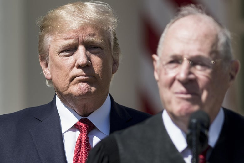 President Donald Trump listens while Supreme Court Justice Anthony Kennedy speaks during a ceremony on April 10, 2017, in Washington.