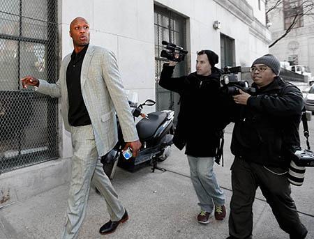 NBA player Lamar Odom arrives to attend a custody hearing.