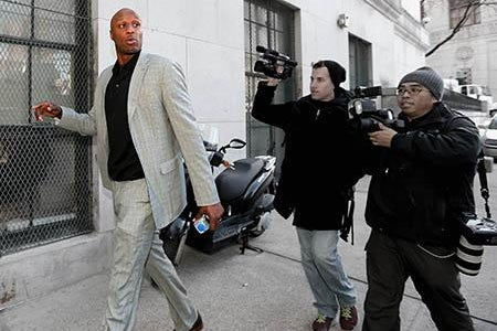 NBA player Lamar Odom arrives to attend a custody hearing.