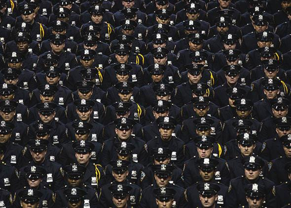 New York City Police Academy cadets attend their graduation ceremony at the Barclays Center on July 2, 2013 in Brooklyn.