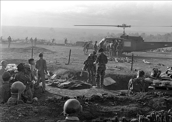 American wounded soldiers of the special forces are evacuated by helicopter from a camp in Plei Me, south Vietnam, November 1965.