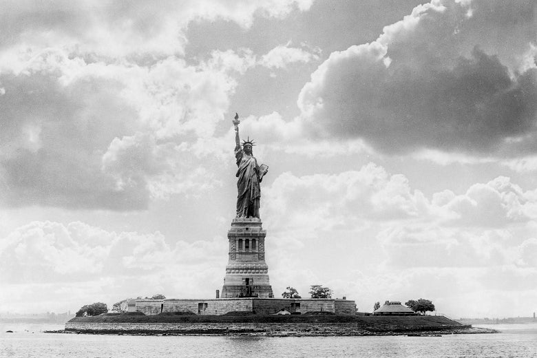 A black-and-white photo of the Statue of Liberty.