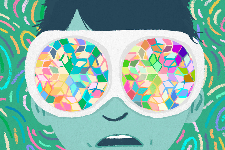 A kid wearing goggles that look kaleidoscopic.
