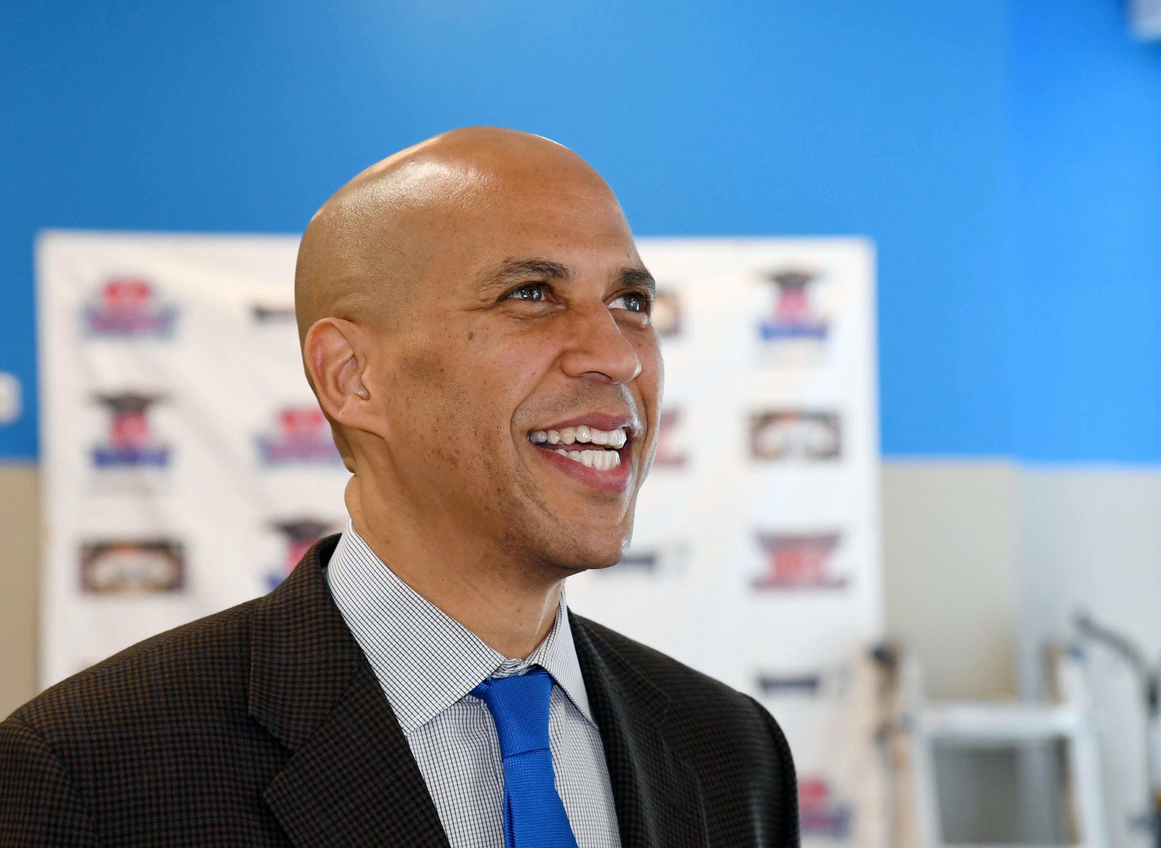 Cory Booker smiling.