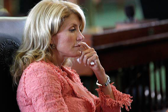 Texas state Democratic Senator Wendy Davis listens as the state Senate meets to consider legislation restricting abortion rights in Austin, Texas.