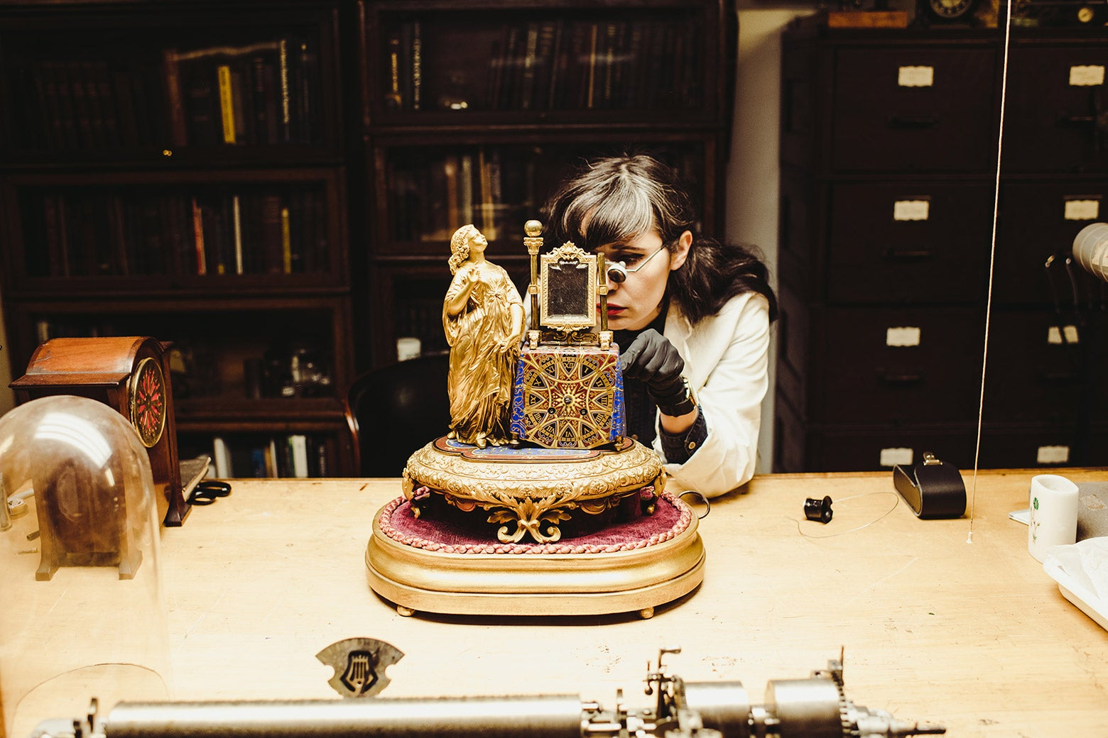 """Brittany """"Nico"""" Cox works on an automaton in her studio."""