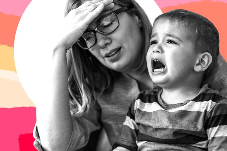A tired woman, wearing glasses, puts her hand to her head as her kid cries.