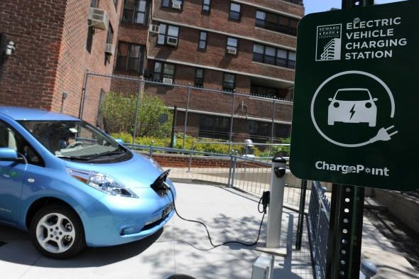 An electric car charges at a station.