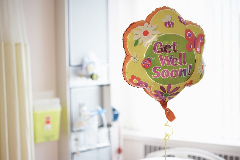 """A """"Get Well Soon"""" balloon in a hospital room."""