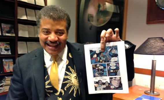 Neil deGrasse Tyson points to his likeness in DC Comics' latest Superman story, Action Comics #14.