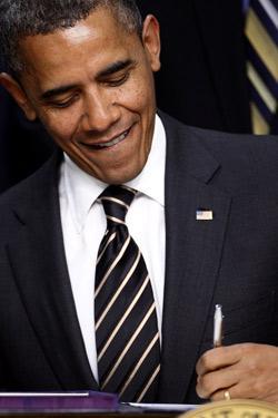 U.S. President Barack Obama signs