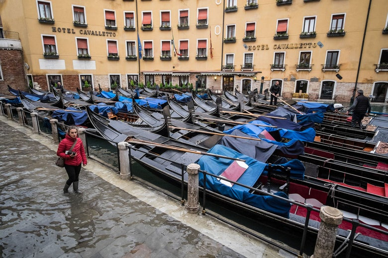 St. Mark's Square, tens of gondolas are moored during an exceptional high tide flooding the city.